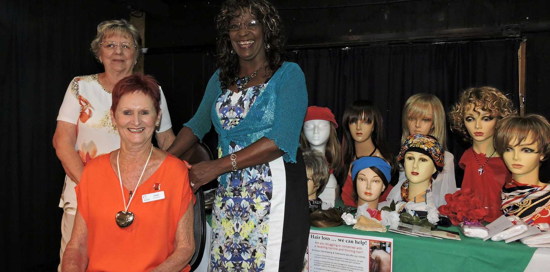 ABOVE: Look Good Feel Better morning tea fundraiser organisers (from left) Joy Davies and Joan Boge with Lynn Arbus, owner of A'Diva Hair & Extension Centre, who demonstrated some of the wig and hair replacement options available to cancer patients.