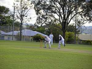Jamien Smith breaks the stumps to run out Laurie Wagner in a Warwick reserve-grade grand final.