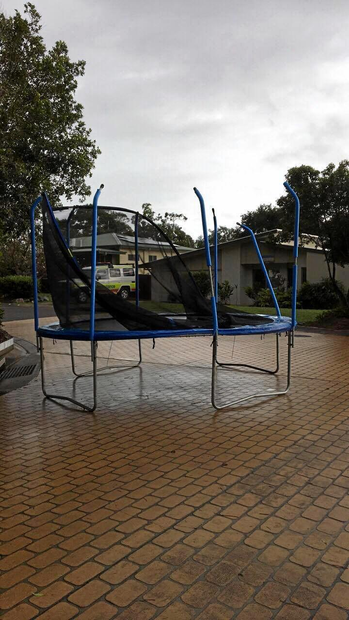 Agnes Water Points North resident Leisa Trickett woke to find a damaged trampoline in her street, a result of the ongoing severe wet weather.