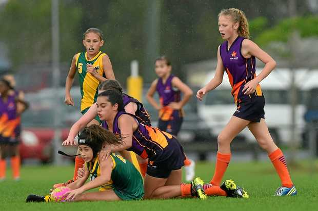 GREAT GAME: The Sunshine Coast collided with Metropolitan West at the 10-12 years girls carnival at Kuluin.