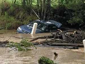 Car swept off Randwick Rd bridge