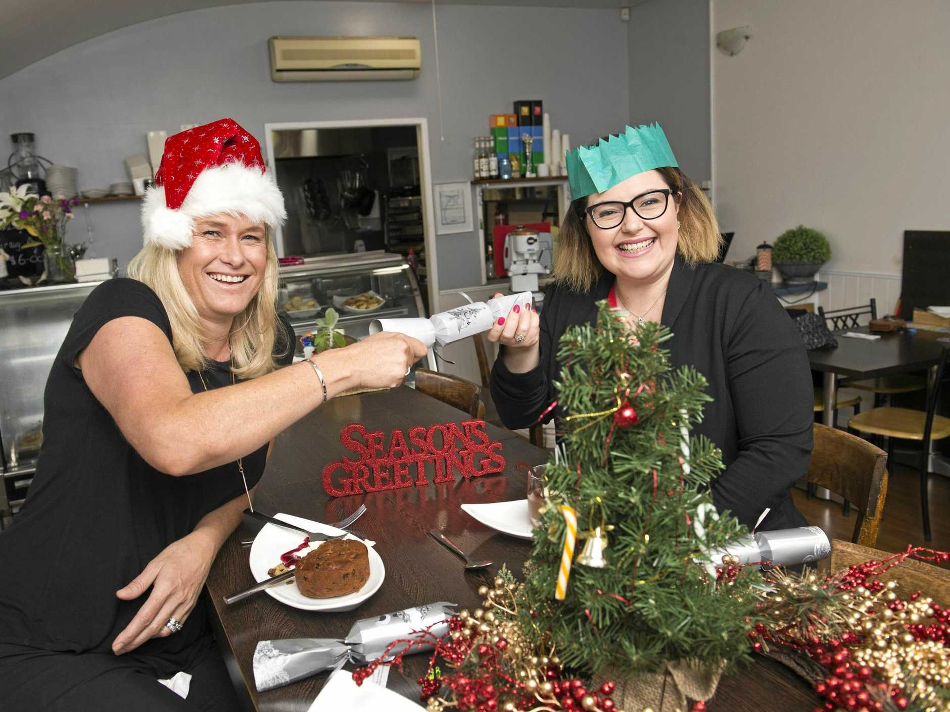Toowoomba Hospital Foundation chief executive Alison Kennedy (left) and Annie White from ParisiAnn Patisserie get ready for Toowoomba's Neighbourhood Christmas Luncheon presented by METRO Church and the Toowoomba Hospital Foundation.