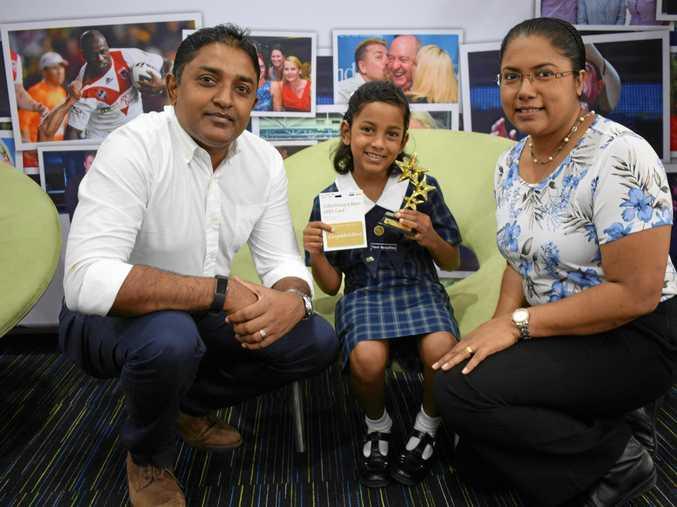 WRITE STUFF: Award winner Thevni Nanayakkara with dad Muditha Nanayakkara and mother Harshani Randiligama.