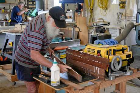 Retired carpenter Mick Conway glues together the timber.