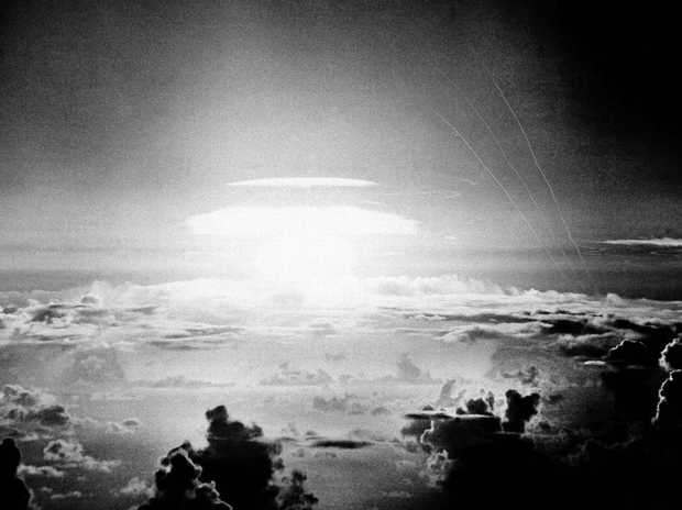 In this May 21, 1956 photo, the fireball of a US hydrogen bomb lights the Pacific sky a few seconds after the bomb's release over Bikini Atoll.