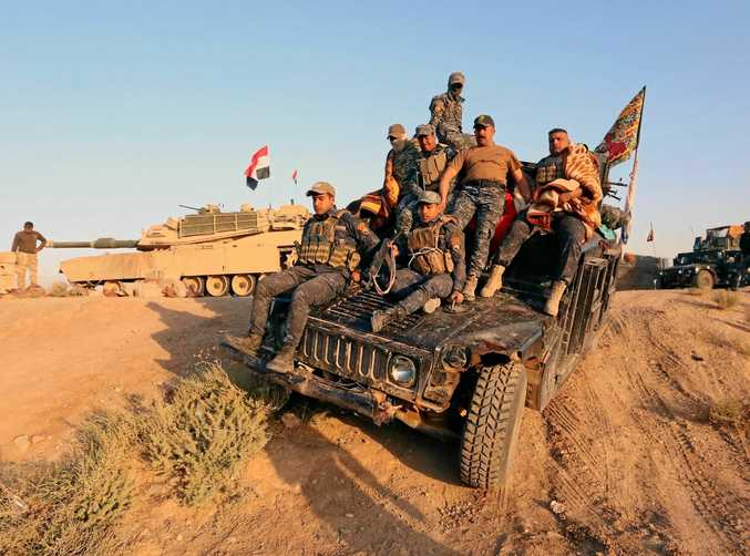 Iraqi federal security forces advance into central Kirkuk city, northern Iraq.