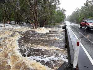 Floodwaters rage under the Hervey Bay Torbanlea Rd at Beelbi Creek.