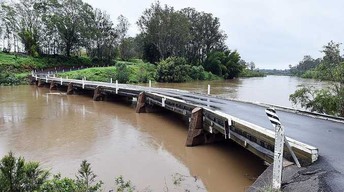 The Mary River bridge at Tiaro with water two metres from the road.