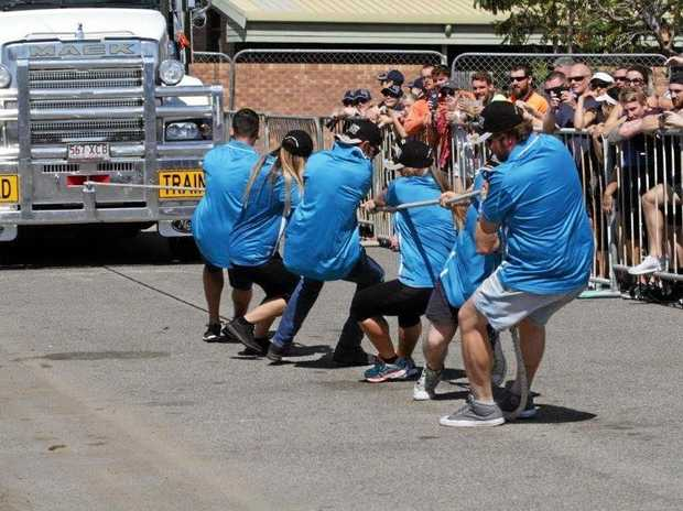 GO, GO, GO: The Riverview Tavern Tuggers team pull the Mack.