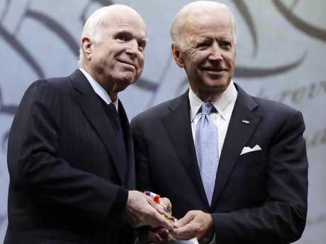 Senator John McCain (left) receives the Liberty Medal from Chair of the National Constitution Centre's Board of Trustees, former Vice President Joe Biden, in Philadelphia. Picture: AP Photo/Matt Rourke