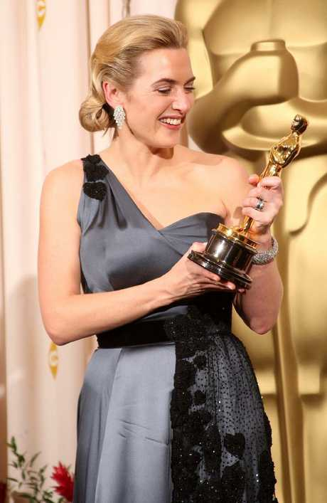 Kate Winslet poses after winning the Best Actress award for The Reader at the 81st Annual Academy Awards.