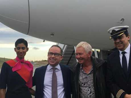 Qantas CEO, Alan Joyce, second from left, unveils the new Dreamliner.