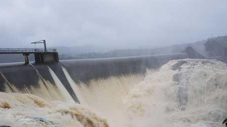 Wappa Dam overflows following days of heavy rain.