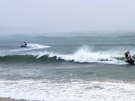 Despite belting rain, waveriders made the most of the surging swell at Mooloolaba.