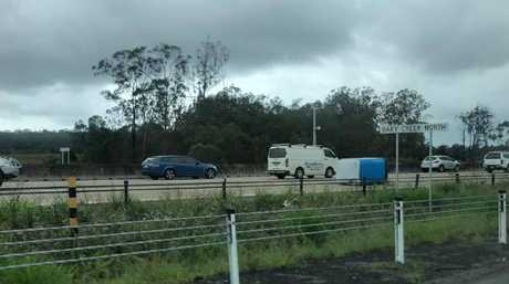 Portaloos fell off a truck on the M1 this morning forcing traffic to swerve around it. Picture: Jay Ingram