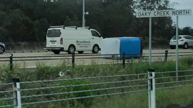 Portaloos fell off a truck on the M1 this morning. Picture: Jay Ingram
