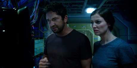 Gerard Butler and Alexandra Maria Lara in a scene from Geostorm.