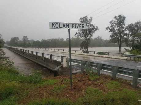 Water flows quickly just beneath the bridge at Kolan River.