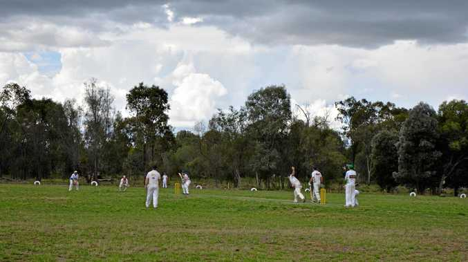 THREATENING: The first game of seniors cricket was overshadowed by storm clouds.