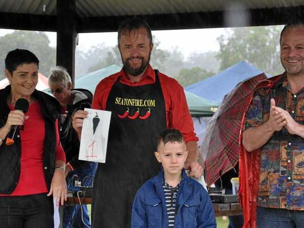 FIREY FUN: Lockyer Valley Mayor Tanya Milligan, organiser Jason O'Connor, colouring Competition winner, and MC Dom Weir at Murphy's Creek Chilli Festival.