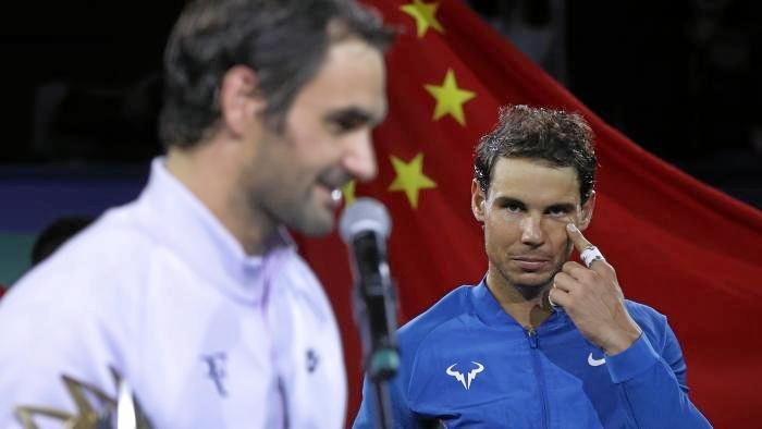 Nadal looks on after Federer claimed the Shanghai Masters