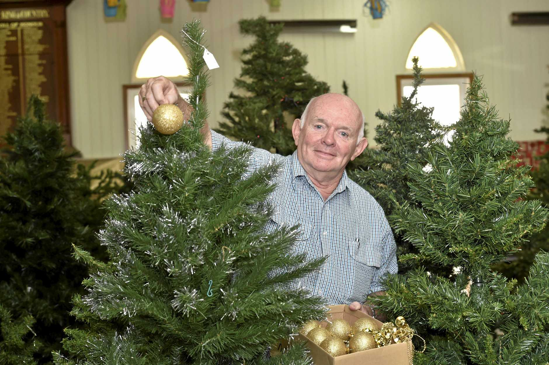 CHRISTMAS TREES: Preparations are underway for the Christmas Tree Festival, Alan Pennington  is one of the organisors.  Photo Bev Lacey / The Chronicle