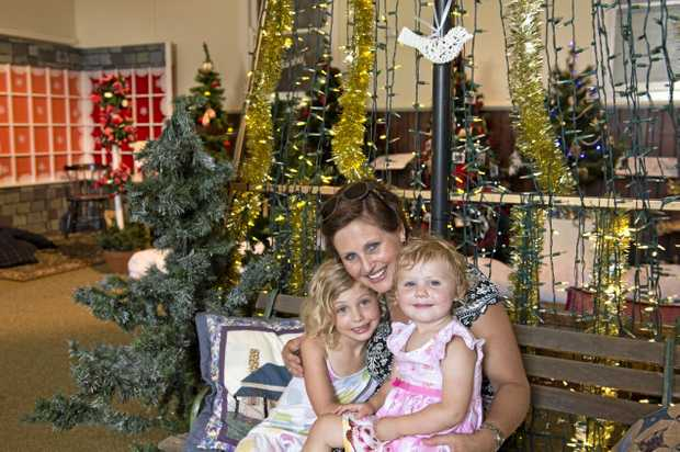 FESTIVE CHEER: Karyn Morgan with daughters Shanae (left) and Teagan Morgan check out last year's Toowoomba's Christmas Tree Festival.