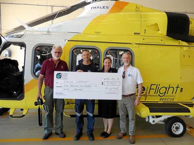 LIFE SAVERS: Boonara Lodge representative Maurie Sheather, LifeFlight Pilot Andrew Caton, Sunshine Coast Coordinator Mandy Hentschel and Lodge representative Steve Rath.