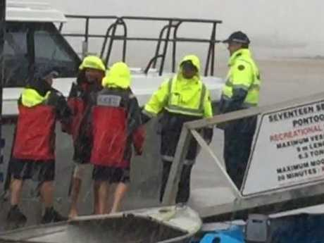 Ruben McDornan steps off a police boat at the town of 1770 after being picked up by a passing yacht following the capsize. Picture: Warrick Wintle