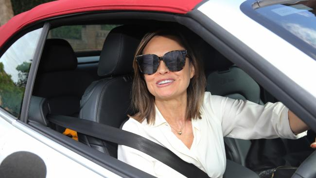 Lisa Wilkinson leaves her Sydney home yesterday. Picture: John Grainger