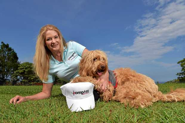 Sharon Chapman with 'Kiri'. The dog is being trained to assist children with visual or learning difficulties.