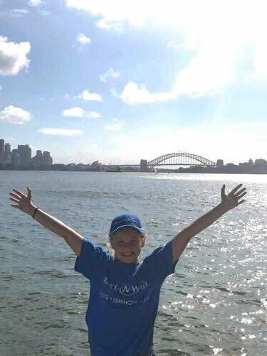Katelyn in Sydney in front of the Sydney Harbour Bridge.