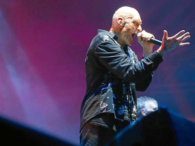 Peter Garrett belts out one of Midnight Oil's great hits to the delight of the audience.