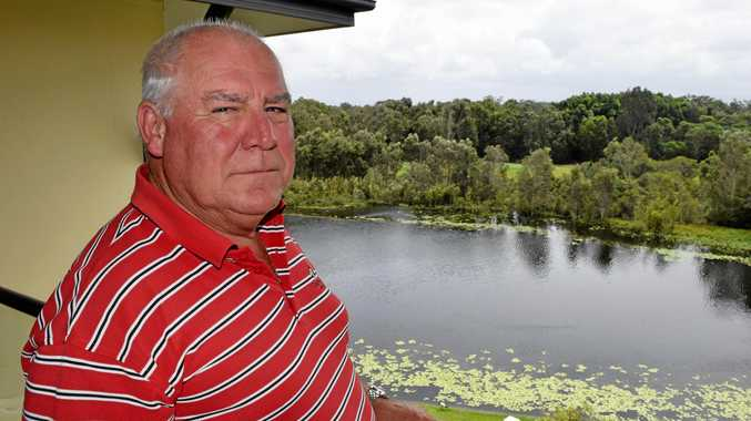 Pelican Waters resident Philip Hattersley is angry about the way in which development plans for housing on the nearby Pelican Waters Golf Club were approved.