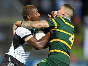REP MATCH: Fiji's Suliasi Vunivalu runs into Australia's Josh Dugan during the Tri Nations tournament in Fiji.