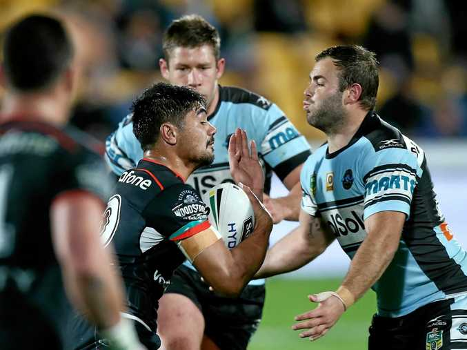 James Bell, left, braces for the tackle of the Sharks' Wade Graham while playing for the New Zealand Warriors in the NRL. Bell will line up for Scotland in a World Cup warm-up games against NSW Country Under-23s at Kingsford Smith Park, Ballina, tonight.