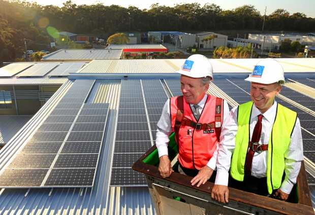 CALOUNDRA MP Mark McArdle and SPS Energy owner Jock Howard overlooking the installation of a massive solar array.