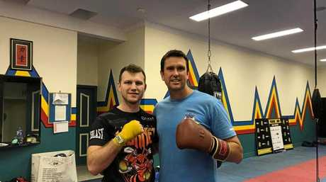 IN THE RING: Coast detective and LNP Ninderry candidate Dan Purdie sparred three, 2-minute rounds with world champ Jeff Horn last night.
