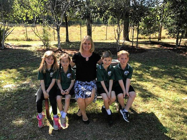 Stokers Siding Public School principal Cherie King with students participating in the Nature Explorers program.