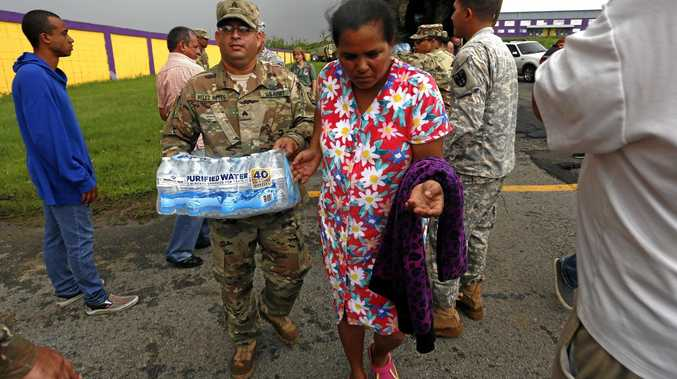 Members of the US military deliver supplies to victims of Hurricane Maria, in Las Piedras, Puerto Rico.