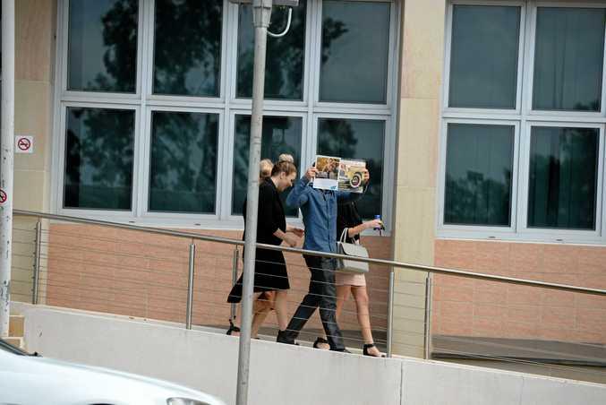 Witness Mikaela Atkins leaves court.