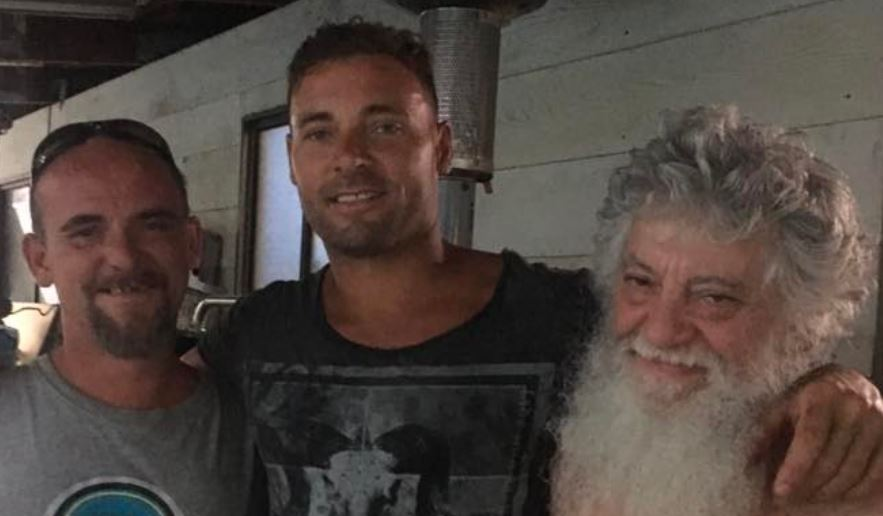 HOLDING OUT HOPE: Missing fisherman Eli Tonks (centre) with his brother (left) and father.