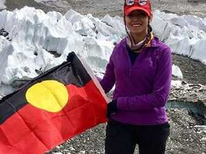 Sarafina Elliott plants the Aboriginal flag on Mt everest Picture: ABC Kimberley