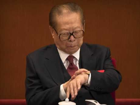 Former Chinese President Jiang Zemin checks his wristwatch during the three hour speech. Picture: AP Photo/Mark Schiefelbein