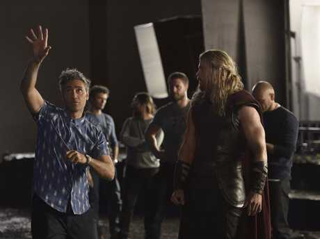 Director Taika Waititi pictured on the set of Thor: Ragnarok with Chris Hemsworth.