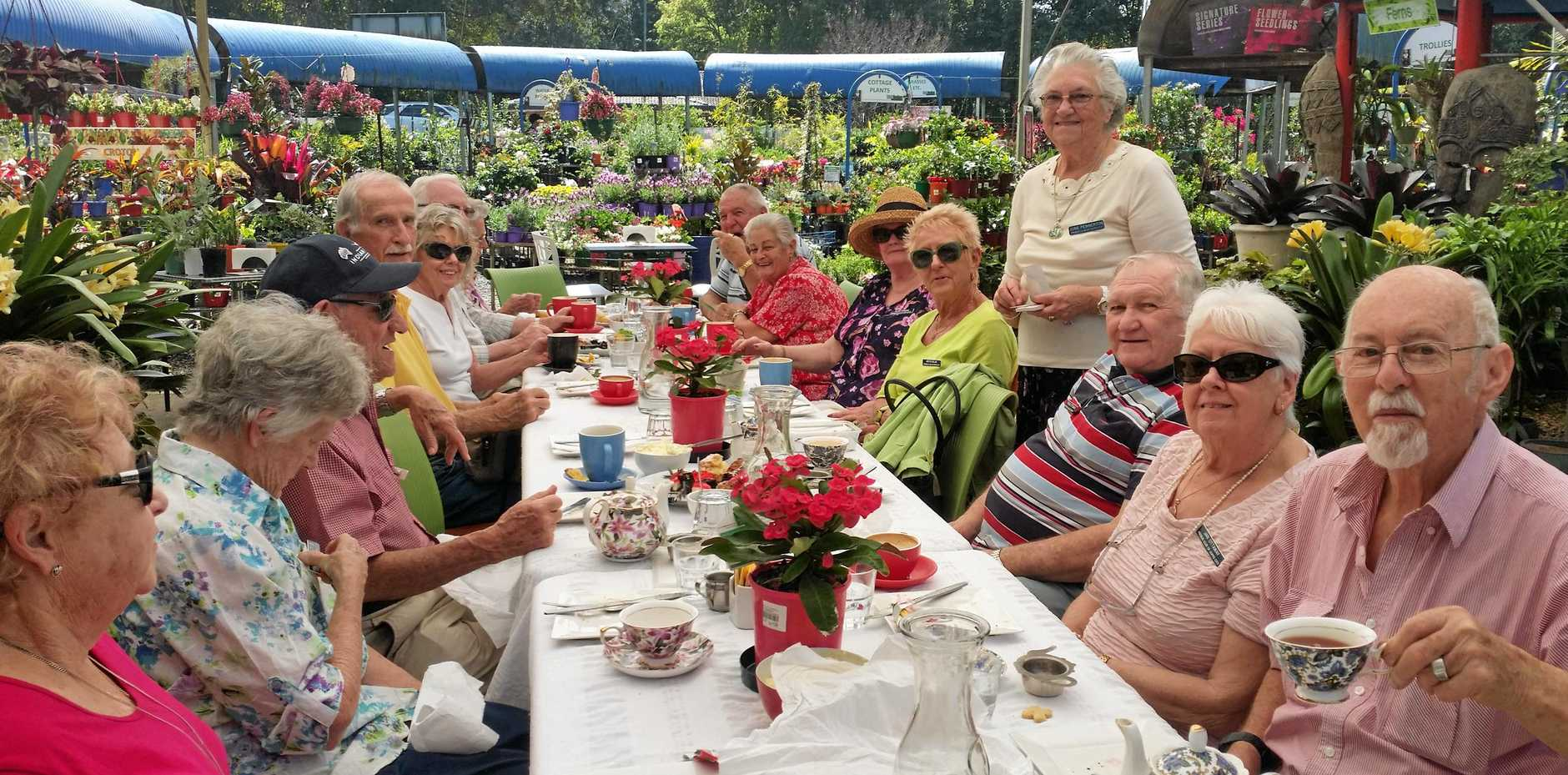 COLOURFUL GROUP: Members of the Probus Club of Coffs City recently had a very enjoyable morning tea amongst the spring time display at Total Gardens.