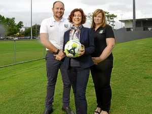 Knights club official Danny Wilson (left), director of seniors Caroline Whyte (right) and Member for Ipswich Jennifer Howard look forward to the new lights.