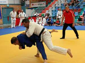 GOLD POWER: Obi Laidlaw from Coffs Harbour PCYC Judo Club (in white) lifts his opponent in a risky throw on his way to a gold medal during last year's Country Championships.