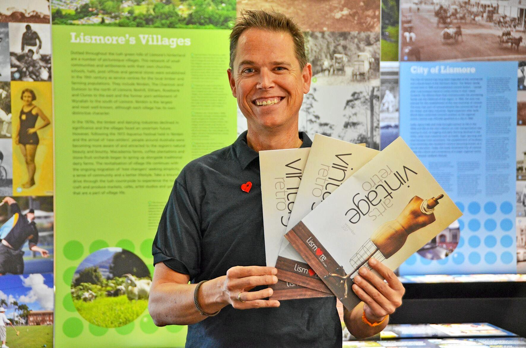 Tourism Services Coordinator Andrew Walker with the 2017 Arts, Vintage & Retro Guide.