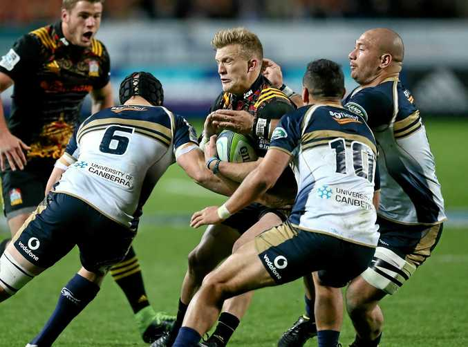 CHIEF: Damian McKenzie of the Chiefs is tackled by Brumbies players during last season.